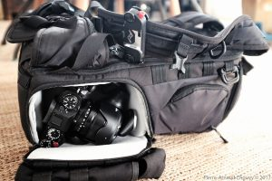 LowePro Pro Tactic 450 AW with one Fuji X-T2, a Peak Design Capture Pro on the left shoulder strap, adn a One Tigris D-ring 025 attached to side MOLLE webbing.