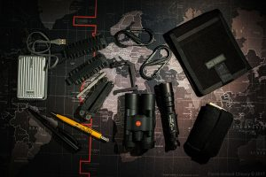 Binoculars, writing material, power bank, torch, knife, small emergency kit, carabineers, etc.
